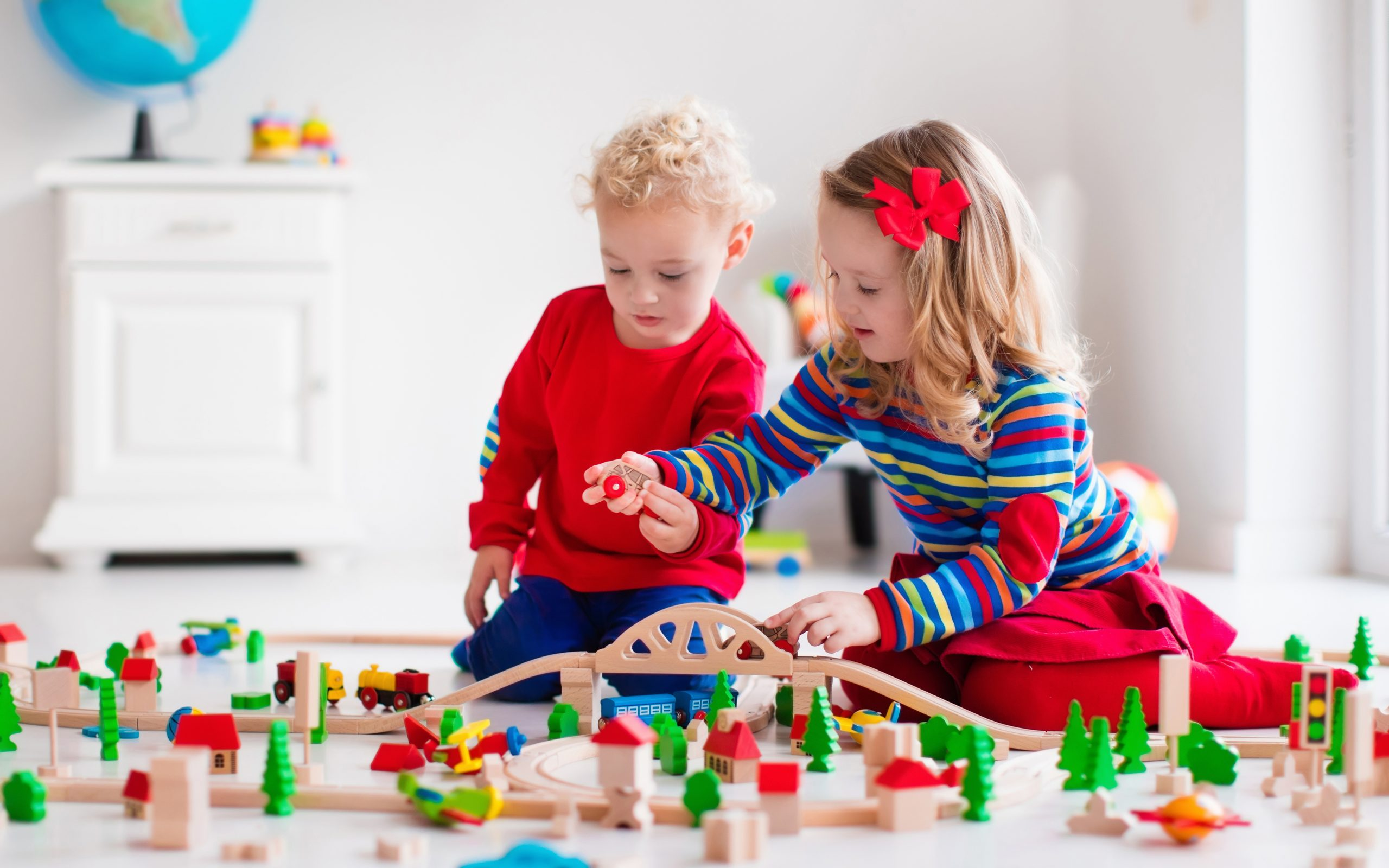children playing with wooden train toddler kid and baby play with blocks trains and cars